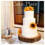 3 tier tall frosted cake with handmade toppers of the bride, groom and their adorable dog <3