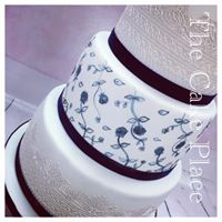 6''8''&10'' cake hand painted middle tier to match the wedding theme and edible lace on the bottom and top tier.
