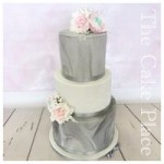 6''8''&10 tall tiers, 2 grey marble effect tiers with a white tier in the middle, topped with handmade roses and ranunculus. Delivered to the Baltic