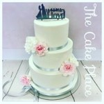 the front of a surprise back cake, the front is white with hand made edible lace and hand made roses........